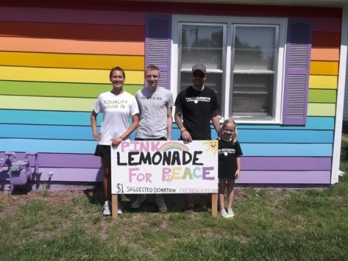 Jayden Sink in front of the Equality House